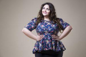 fat woman on beige studio background
